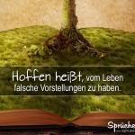 Buch mit Wiese, aus dem ein Baum wächst