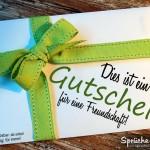Gutschein mit grüner Schleife für eine Freundschaft