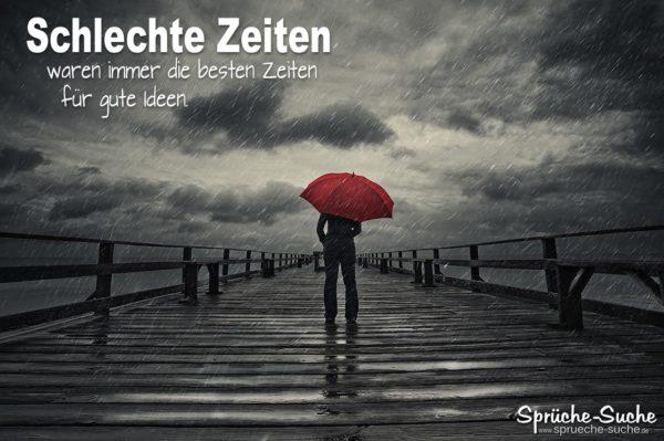 Schlechte Zeiten Gute Zeiten Sprüche - Mann mit rotem Regenschirm auf Steg im Regen